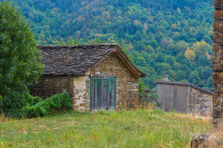 Solitary houses in the mountains of the natural park of ordesa huesca, spain