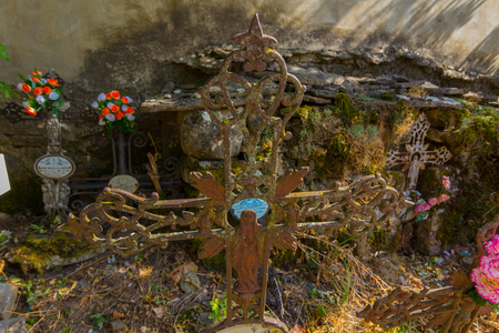 Old abandoned cemetery with wrought iron crosses