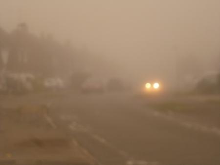 Headlights in Mist Stock Photo