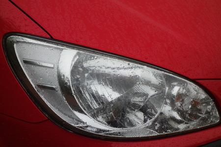 headlamp: Headlamp of Red Car Stock Photo