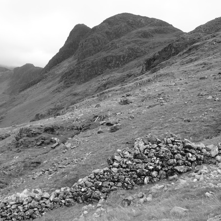 Haystacks and Dry Stone Wall