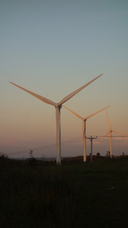 Wind Turbines at Dusk Stock Photo