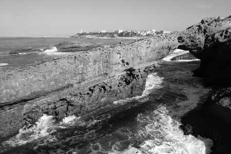 rock arch: Rock Arch and Lighthouse, Biarritz Stock Photo