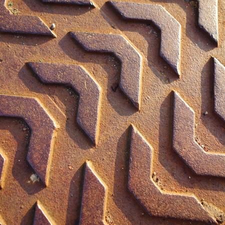 manhole: Sunlit Manhole Cover Pattern