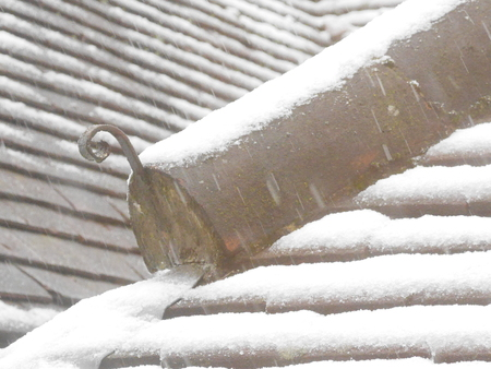 Snow on Rooftop Ridge and Tiles Stock Photo