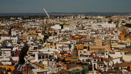 Seville cityscape with old and new buildings in Seville, Spain, Andalusia, with hills in distance Фото со стока
