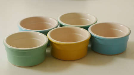 Group of blue green and yellow pastel coloured ramekin bowls