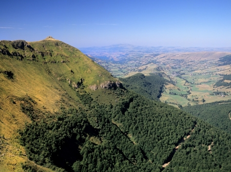 a view from the summit of puy mary in the parc naturel regional des volcans dauvergne in the french massif central, cantal, auvergne, france, europe - the area is an area of extinct volcanoes photo