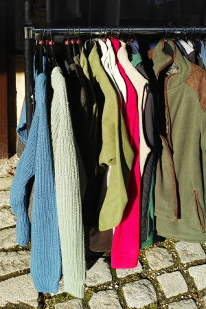 a clothes rack with outdoor wear