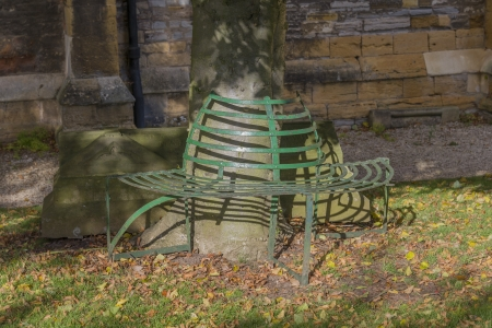 seat outside a church England photo