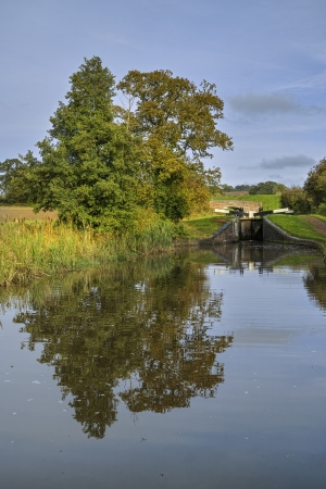 a lock gate on a canal on the inland waterways network of navigable canals and waterways in the english and british countryside in the uk, united kingdom, great britain, europe Stock Photo - 16292306