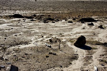 Bleak stones and showdows on a beach. Banco de Imagens