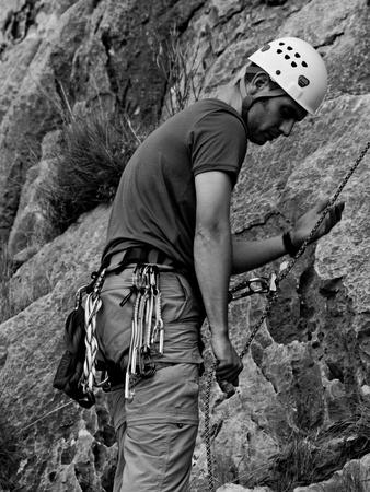 belaying: Mike belaying - Sierra de Toix, Costa Blanca, Spain Stock Photo
