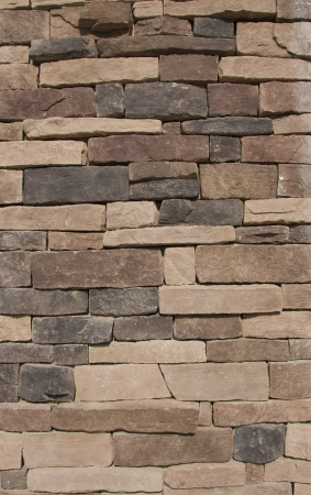 Texture of a Brown Stone Wall Stock Photo