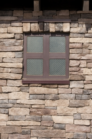 Texture of a Brown Window in a Stone Brick Wall
