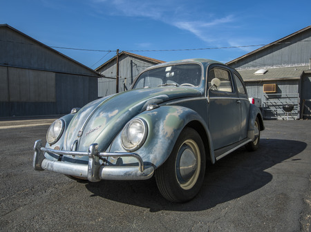 A classic VW bug parked in front of hangars at the Santa Paula Wings and Wheels event on May 4th, 2014