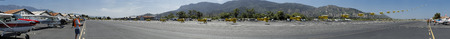 A panorama of a bi-plane taking off during the Santa Paula Wings and Wheels event on May 4th, 2014