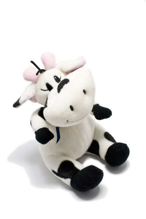 cuddly: Cuddly stuffed cow toy isolated over a white background. Stock Photo