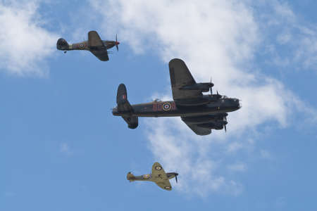 Farnborough, England, UK - July 24, 2010: A Hurricane, Spitfire and Lancaster Bomber of the Battle of Britain Memorial Flight at Farnborough 2010.