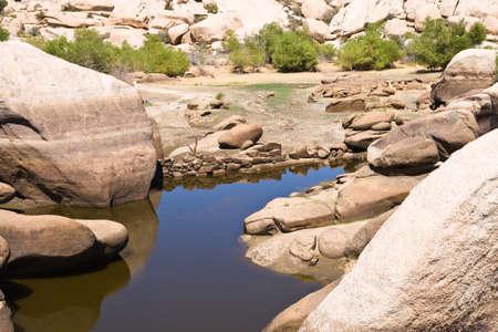 barker: Barker Dam, during a dry hot summer, Joshua Tree National Park, California.