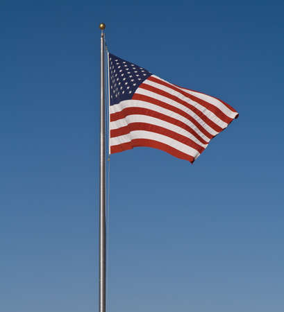 flag usa: The Stars and Stripes set against a perfectly blue sky Stock Photo