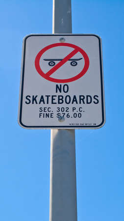 A no skateboards sign against a blue sky Stock Photo - 15256211