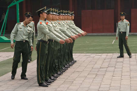 liberation: Beijing, China - May 16, 2009: A row of Peoples Liberation Army soldiers stand for inspection.