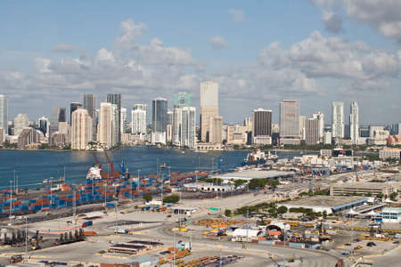 Miami, Florida, USA - May 4, 2012: Container ships being loaded at the Port of Miami. It is the largest container port in the United States.