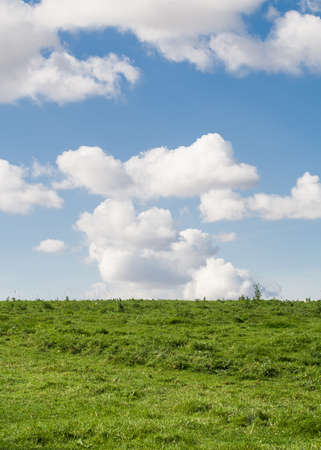 Clouds passing by an english hillside on a Summer's day. photo