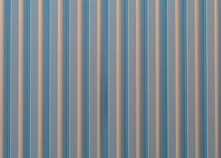 aluminium wallpaper: Corrugated aluminium wall cladding reflecting the early evening sunlight. Stock Photo