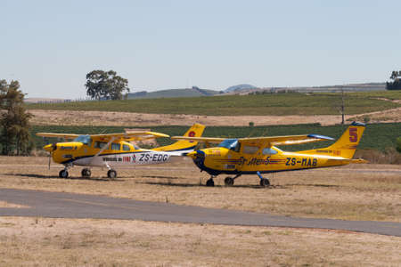 aileron: Stellenbosch Airfield, South Afirca - February 08, 2012: Two parked Cessna spotter aircraft of South African firefighting organisation Working on Fire (WoF) at Stellenbosch airfield, South Africa. WoF trains young people from marginalised communities as s Editorial