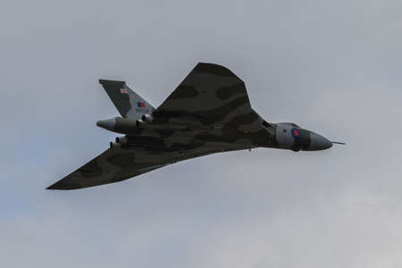 Farnborough, England, UK - July 24, 2010: Last flying Vulcan bomber B.2 XH558 at Farnborugh 2010 Airshow.