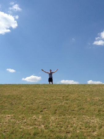 disc golf: man on top of a hill at a frisbee golf course in Denton tx