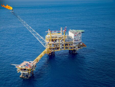 Offshore oil and gas platforms are in the process of releasing gas to the flame platform to reduce the pressure in the production process and forward the converted refinery. For the petroleum industry Stock Photo