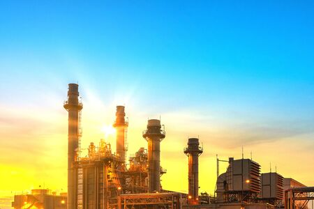 Power plant zone generating electricity at sunset- images