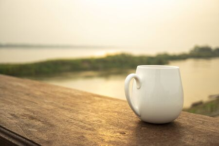 Morning air by the river with your favorite coffee. Banco de Imagens