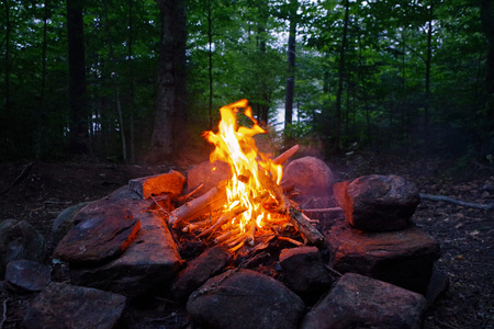 Bright Campfire at Campsite in the Adirondack Mountains of Upstate New York