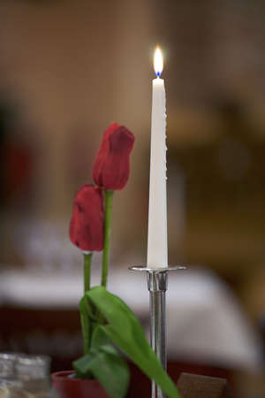 candle and roses  photo