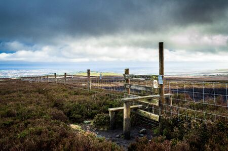 Wooden stile and wire fence. Ilkley moor. Yorkshire