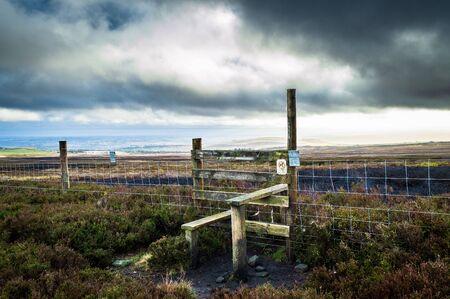 Stile and fence. Ilkley moor. Yorkshire 版權商用圖片