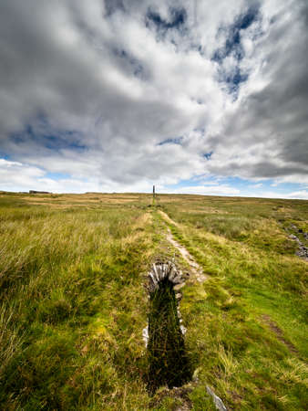 This old ruined flue winds it's way over the moors, a reminder of the toil of the lead miners. Grassington moor lead mines. Yorkshire Dales National Park