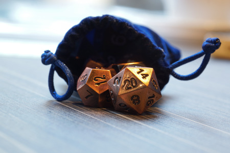 A set of polyhedral dice used for role playing games such as Dungeons & Dragons, the dice are used to determine how successful a player is in their actions within the game. The twenty sided dice is the most common used die in these tabletop games 版權商用圖片 - 84159258