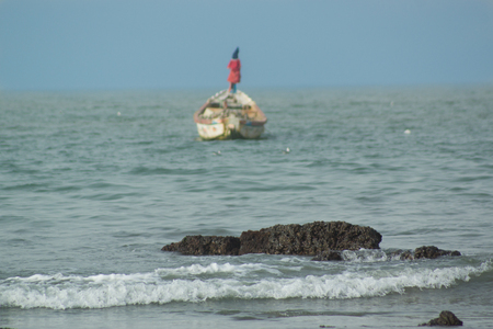 A boat in the atlantic ocean in The Gambia, West Africa. The boat was just outside the fishing village of Bakau
