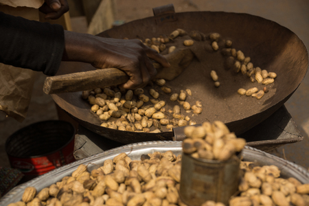 A bowl of peanuts being prepared in Serrekunda Market, Gambia