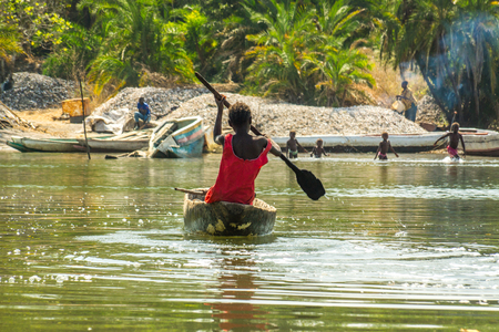 African children practice canoeing in the River Gambia near Makasutu forest in Gambia, West Africa