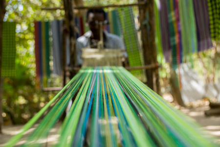 An african male shows traditional weaving in Makasutu forest, The Gambia, Africa Standard-Bild - 94807797