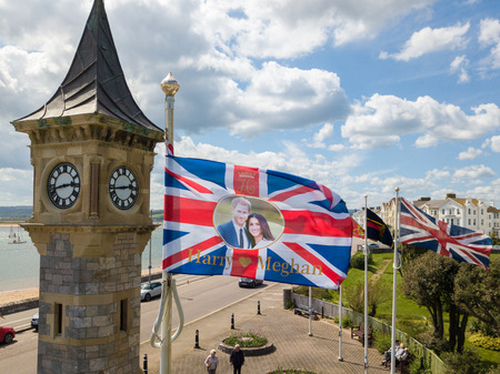 A union jack flag showing Harry & Megan  is flying in Exmouth, Devon as the royal wedding date draws nearer.