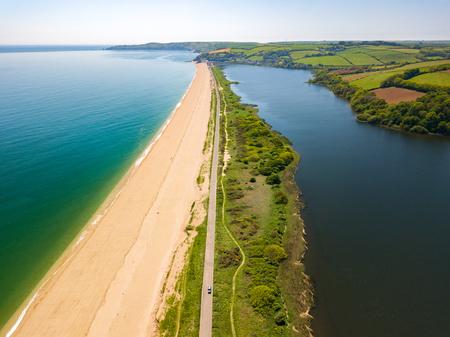 An aerial drone landscape photograph taken of Slaptop Sands in Devon, UK