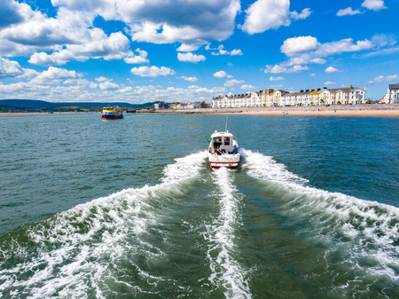A boat in the sea of Exmouth, Devon, UK Editorial