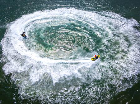 Jet skis cause a circle of whitewash in the sea near Exmouth, Devon, UK Banco de Imagens